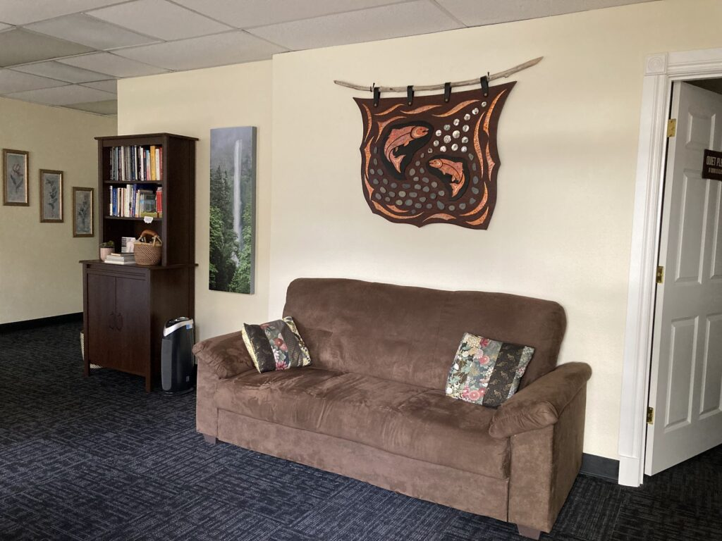 Waiting room with comfortable couch and beautiful art