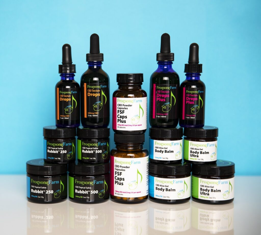 Bottles and tubs of Frogsong CBD products.